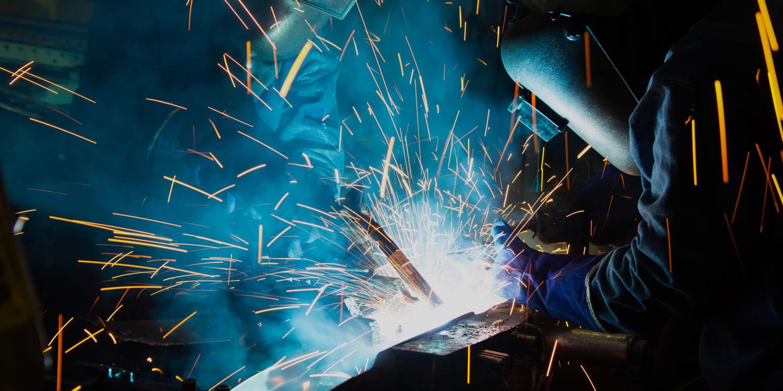 Welder at work - industrial marketing services for manufacturers